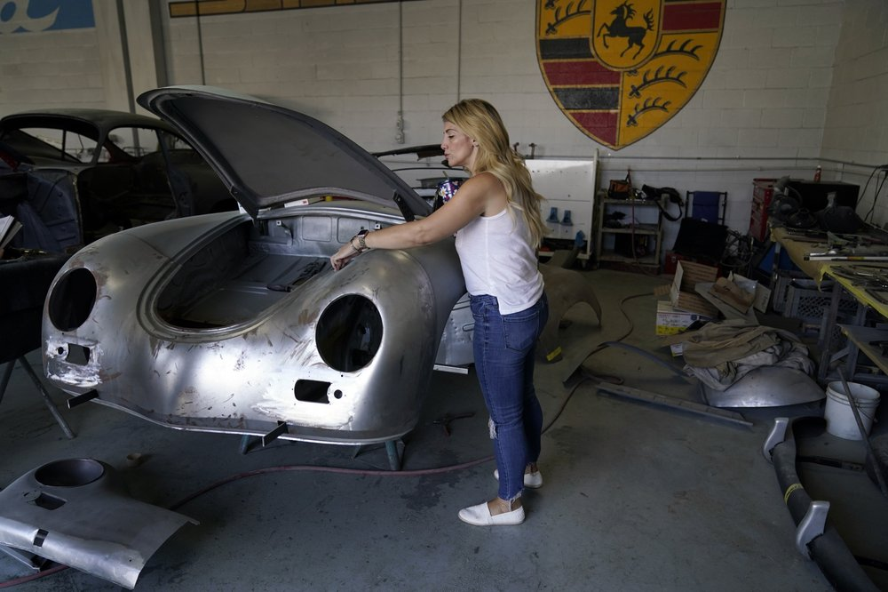 Laurina Esposito, co-owner of Espo Restoration, which specializes in restoring Porsches, inspects a frame at her Los Angeles shop Monday, Oct. 19, 2020. (AP)