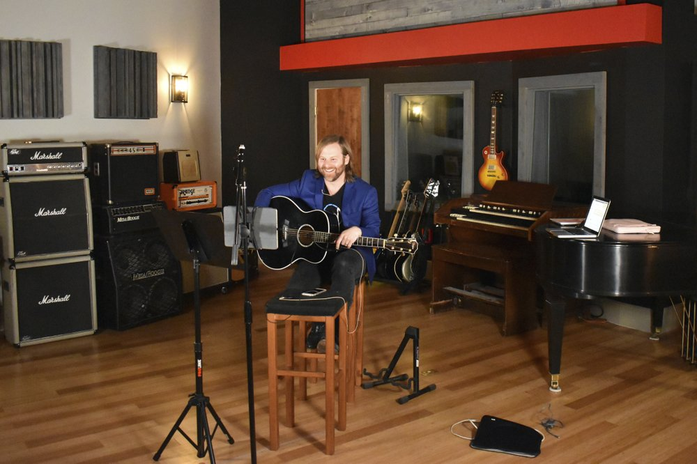 Benji Harris, an artist/songwriter and client executive for a company called Song Division, leads a virtual songwriting team building workshop for a corporate client at The Record Shop, a recording studio in Nashville, Tenn., owned by Sean Giovanni, on March 31, 2020. Giovanni got an important lesson that will help his business long after the pandemic has subsided. The Record Shop doesn't have to be limited to what it can produce onsite. (Sean Giovanni via AP)