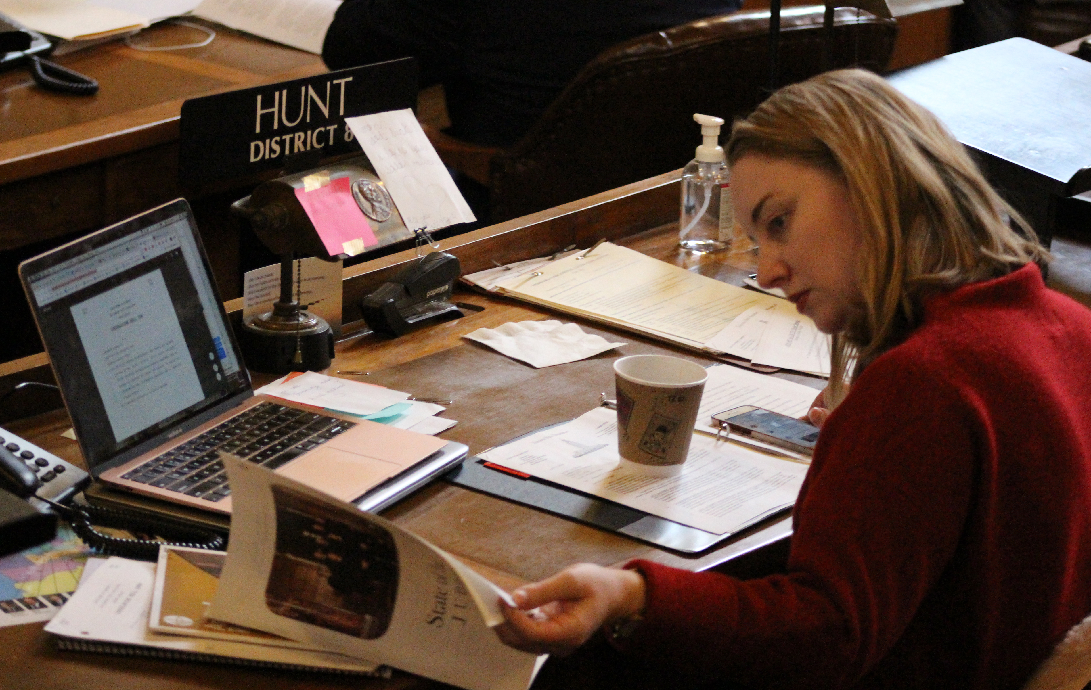 State Sen. Megan Hunt of Omaha looks at a copy of the State of the Judiciary address at the Nebraska Legislature on Wednesday, Jan. 22, 2020. (Photo by Scott Stewart)