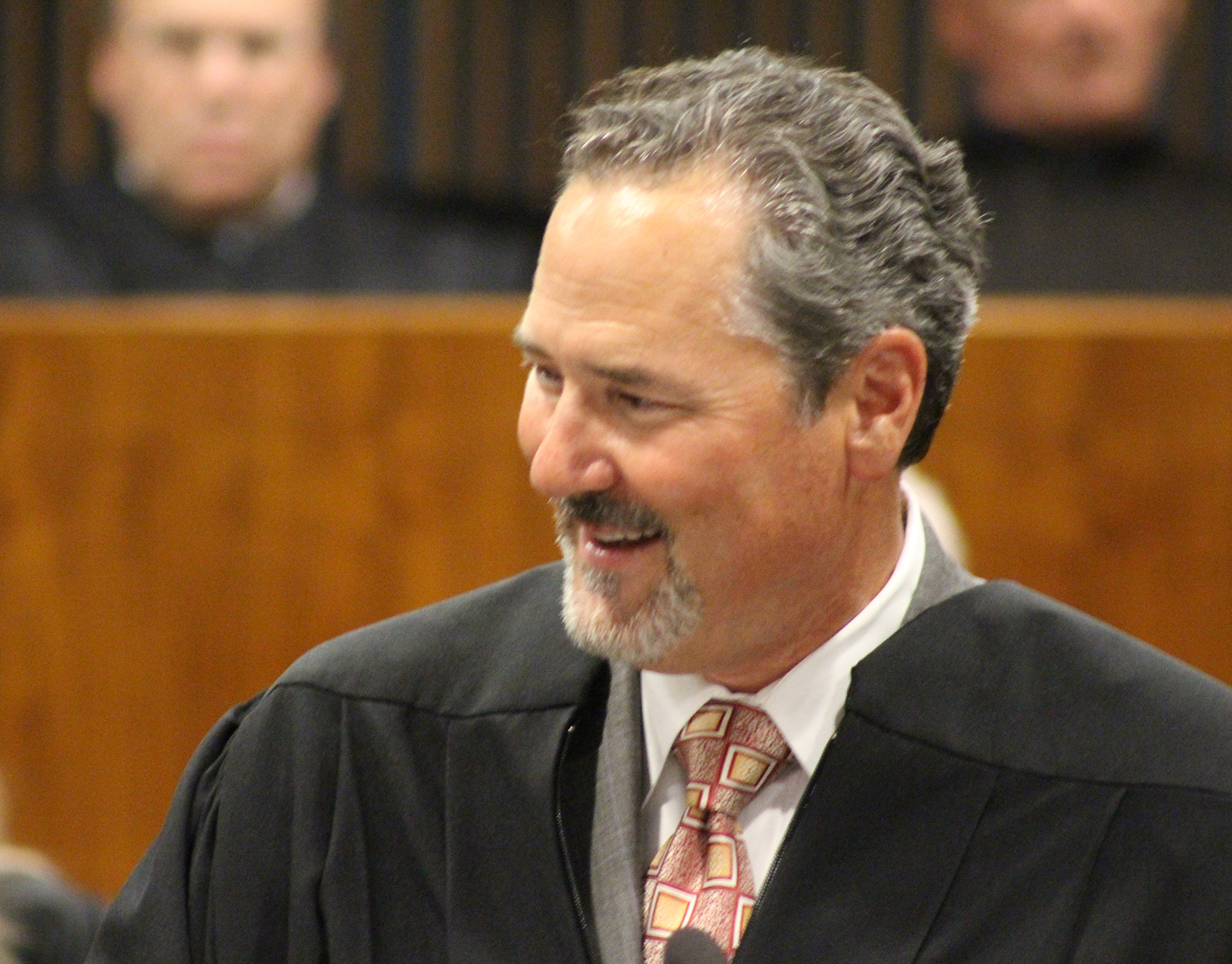 Judge Grant A. Forsberg smiles as he delivers remarks following his oath of office in the legisla-tive chambers of the Omaha-Douglas Civic Center on Friday, Aug. 2, 2019. (Photo by Scott Stewart)