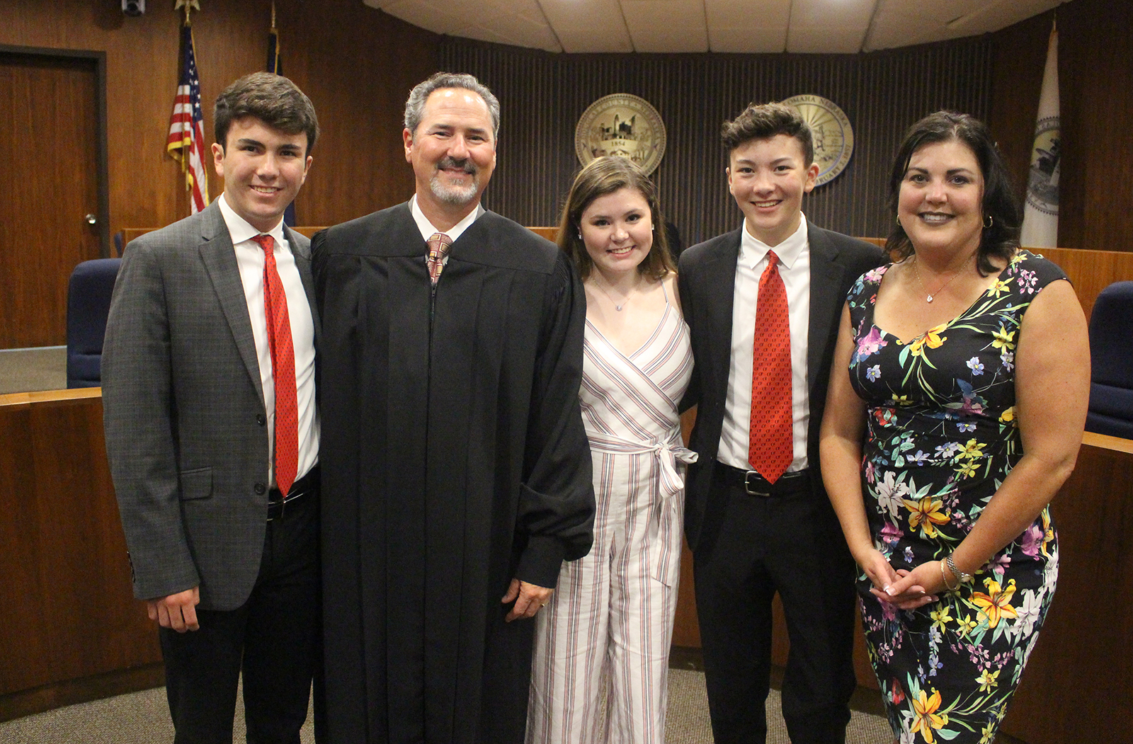 Judge Grant A. Forsberg, second from left, stands for a portrait with his children, from left, Seth, London and Devon, and wife Shawna, far right. (Photo by Scott Stewart)