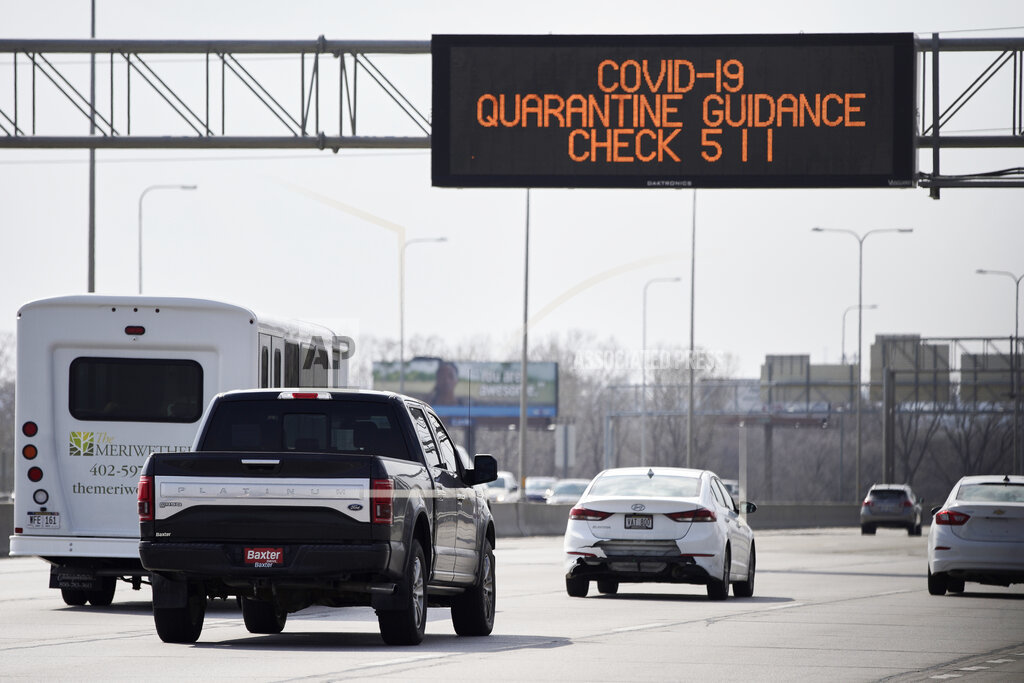 A road sign over Interstate 80 in Omaha directs motorists to contact 511 for quarantine guidance, March 31, 2020. Travelers coming back to Nebraska from out of state are asked to self-quarantine. (AP)
