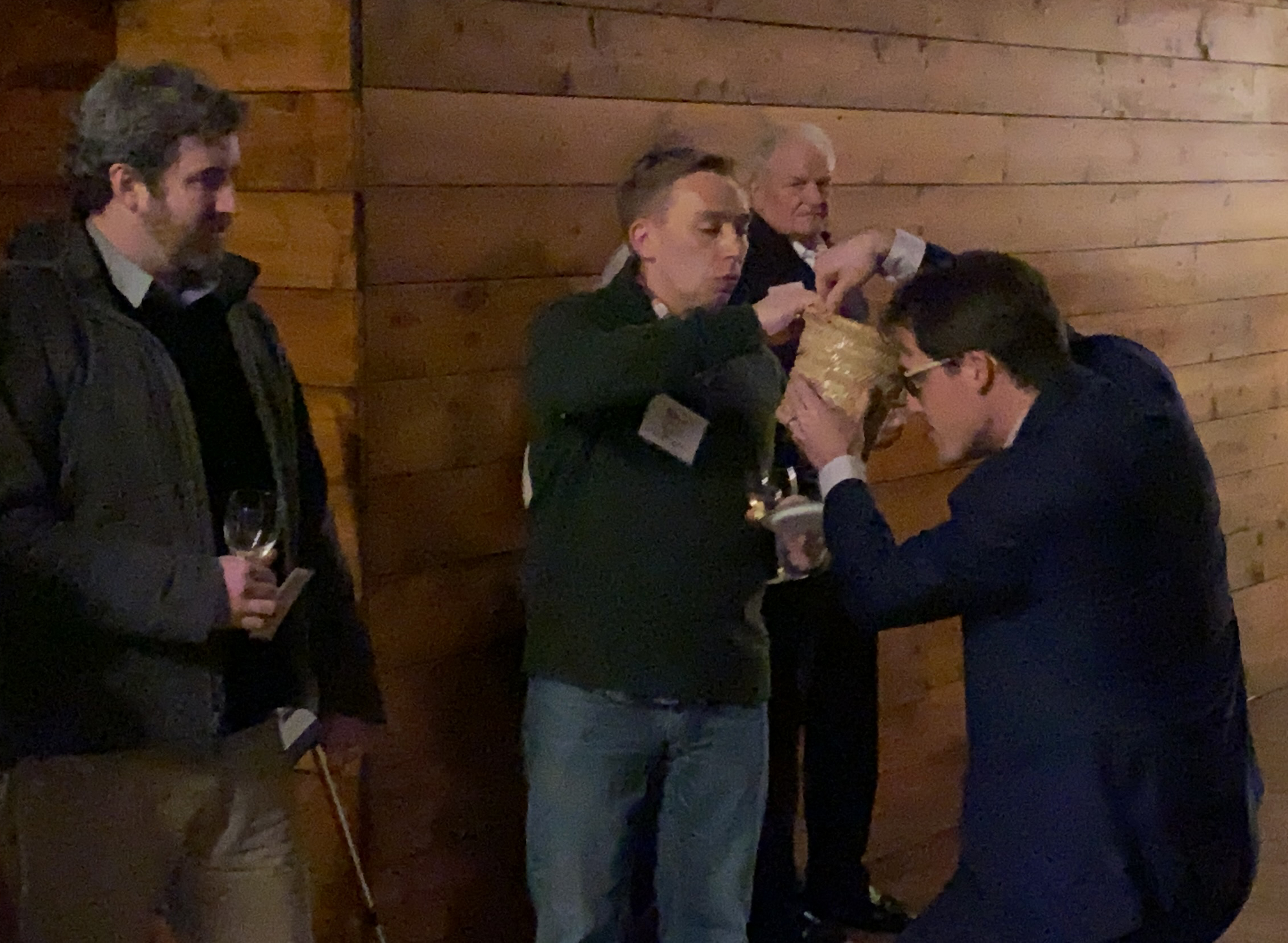 Omaha Bar Association Executive Director Dave Sommers selects the winner of a raffle prize at the OBA Wine Tasting event Friday, Jan. 24, 2020. (Photo by Scott Stewart)