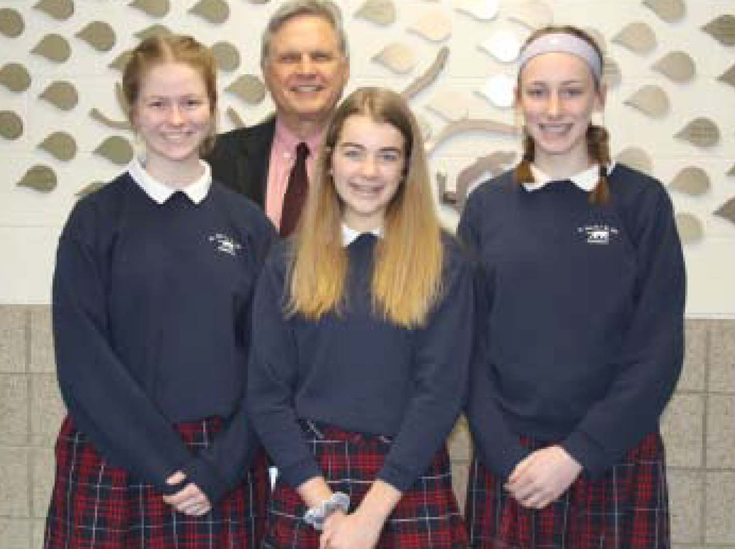 Judges selected, from left, Meg Raabe, Second Place; Gigi Salerno, First Place; and Abby Wessling, Third Place in the Essay Contest. All three are students of Greg Gorske, history teacher at St. Pius/St. Leo. (Photo by Lorraine Boyd)