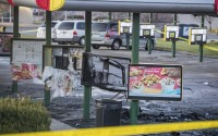 This Sunday, Nov. 22, 2020 photo shows the scene after a shooting at a Sonic restaurant on Saturday night where two people were killed and two others wounded in Bellevue. Video obtained by news outlets showed a vehicle on fire in the parking lot. (Chris Machian/Omaha World-Herald via AP)