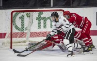 """Nebraska-Omaha forward Ryan Brushett looks for a shot against Miami goaltender Ludvig Persson during an NCAA hockey game on Saturday, Dec. 5, 2020, in Omaha. The University of Nebraska at Omaha hosted the first segment of the National Collegiate Hockey Conference, which was conducted in a """"pod"""" format at Baxter Arena, after a delayed start to the NCHC season due to the coronavirus. (AP)"""