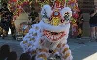 The Linh Quang Lion Dance Troupe performs at Stinson Park, Saturday, Sept. 26, 2021.  Find more photos on page 3 and a gallery at omahadailyrecord.com. (David Golbitz/Daily Record)