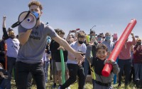 Josh Swain, left, declares Lincoln native 4-year-old Joshua Vinson Jr., right, the ultimate Josh after the Josh fight took place in an open green space at Air Park on Saturday, April 24, 2021, in Lincoln. What started as a mid-pandemic joke took on life as a mixed bag of individuals sharing only their name came to battle it out to determine the rightful owner of the name.               (Kenneth Ferriera/Lincoln Journal Star via AP)