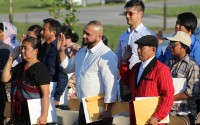 New U.S. citizens take the Oath of Allegiance during a 9/11 Memorial Ceremony in Bellevue on Sept. 11, 2019. (Photo by Scott Stewart)