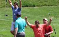 Golfers celebrate a successful chip shot that made it into the hole during the OBA Field Day golf tournament at Champions Run, Monday, July 19, 2021. (Scott Stewart/Daily Record)