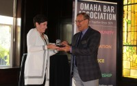 Incoming Omaha Bar Association President Judge Stephanie Hansen, left, presents outgoing OBA President Dave Koukol with a crystal gavel during the OBA President's Reception at Lucille's in the Old Market, July 21, 2021. (David Golbitz/Daily Record)