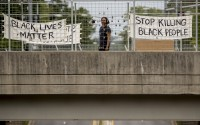 """Signs that read """"Black Lives Matter"""" and """"Stop Killing Black People"""" hang on an overpass on North Capitol Street in Washington, June 2, 2020, following days of continuing protests over the death of George Floyd. Floyd died after being restrained by Minneapolis police officers. (AP)"""