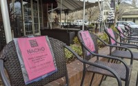 This Monday, Dec. 21, 2020, photo shows a line of empty chairs bearing the names of workers who have lost their jobs during the pandemic, outside Crumbs restaurant in Danville, Calif. (AP)