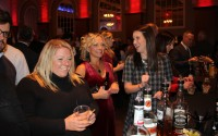 Revelers enjoy drinks and each other's company at the 2017 Barristers Club Christmas Show. The annual show is one holiday party that won't happen this year due to the coronavirus pandemic. Office parties have also had to be reimagined in a year when many professionals shifted to working from home to maintain social distance from their colleagues. (Lorraine Boyd/Daily Record)