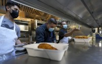 Teo Perez, from left, works in the kitchen with Jorge Morales and Jaime Hernandez at Brenda's French Soul Food in San Francisco, Wednesday, Dec. 9, 2020. (AP)