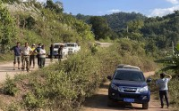 A group claiming to be local villagers use vehicles to block the roads leading to a mine shaft near Danaoshan in southern China's Yunnan province on Tuesday, Dec. 1, 2020. The mine shaft once harbored bats infected with the closest known relative of the virus that causes COVID-19. (AP)
