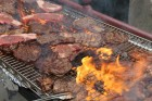 Steaks cook on the grill at Hanscom Park during the Barristers' Club Steak Fry, Thursday, July 15, 2021. (David Golbitz/Daily Record)