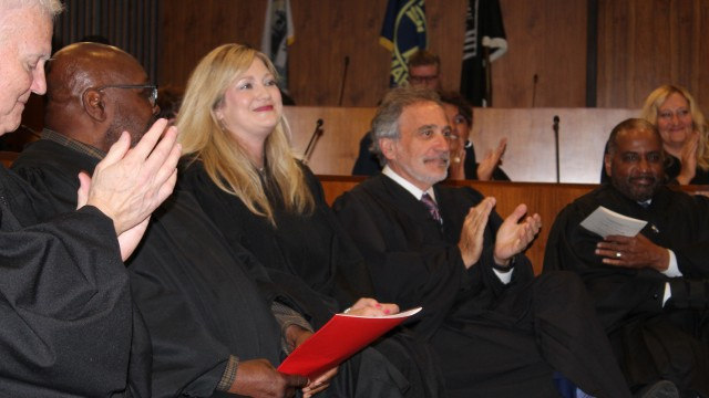 Douglas County Juvenile Court Judge Candice J. Novak, center, receives a round of applause during her investiture ceremony in the Legislative Chamber of the Omaha-Douglas Civic Center, Friday, June 11, 2021. (David Golbitz/Daily Record)