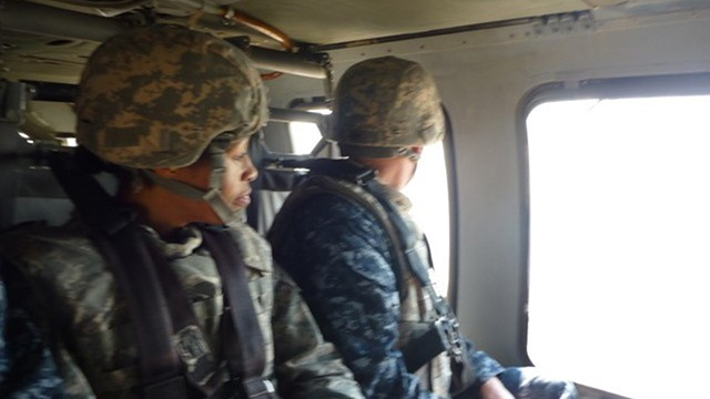 Maj. Gen. Marcia M. Anderson, left, views Iraq from the air in 2011. (Courtesy U.S. Courts)